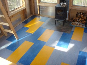 Linoleum in either sheets or tiles can be very striking.