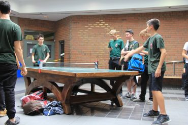 Students enjoy one of two large-timber ping-pong tables in the atrium's of Patrick Fogarty Catholic S.S.