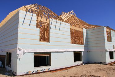 Some ICF block manufactures have added rigid foam panels with built-in strapping for those wishing to continue with 'stick' construction. (photo: John Bleasby)