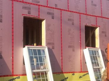 Adding rigid foam to the outside of the wood framing is becoming more common in order to boost R-values and reduce heat transfer loss