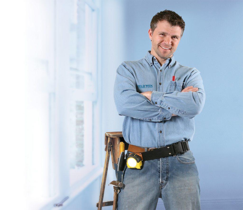Contractor in front of a JELD-WEN window