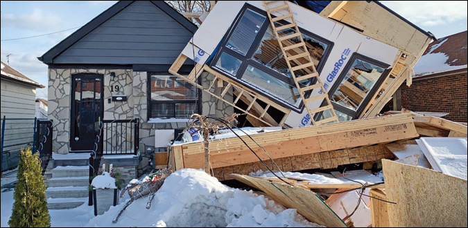 Lean on me: A second-storey addition to this home in the west end of Toronto toppled over in high winds. Luckily, no one was injured.